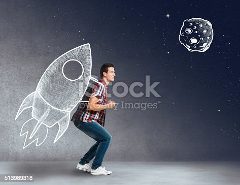 istock Young man with a rocket on his back 513989318