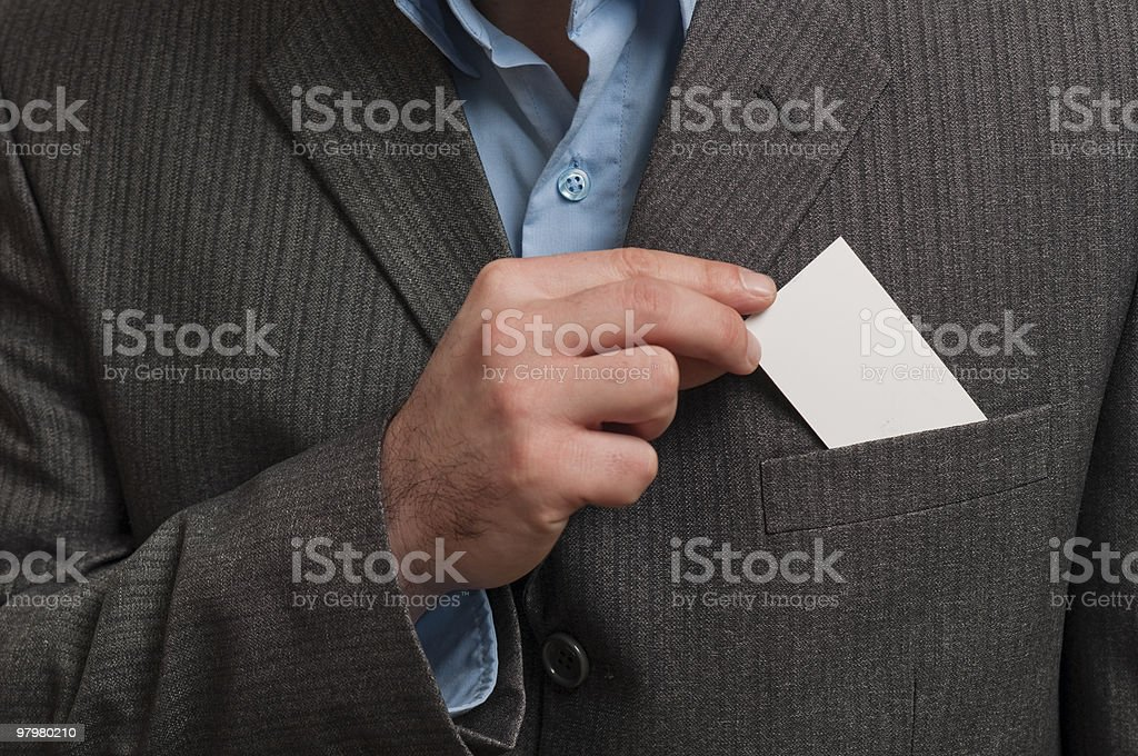 young man with a suit card removed royalty-free stock photo