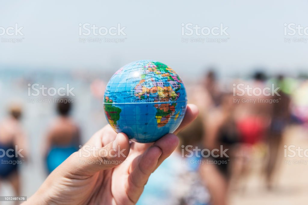 young man with a world globe in his hand stock photo