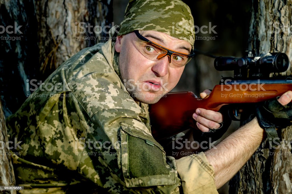 young man with an air rifle stock photo