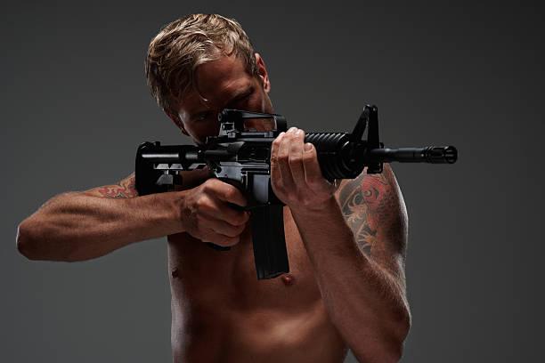Portrait Young Man Gun On Black Stock Photo (Edit Now