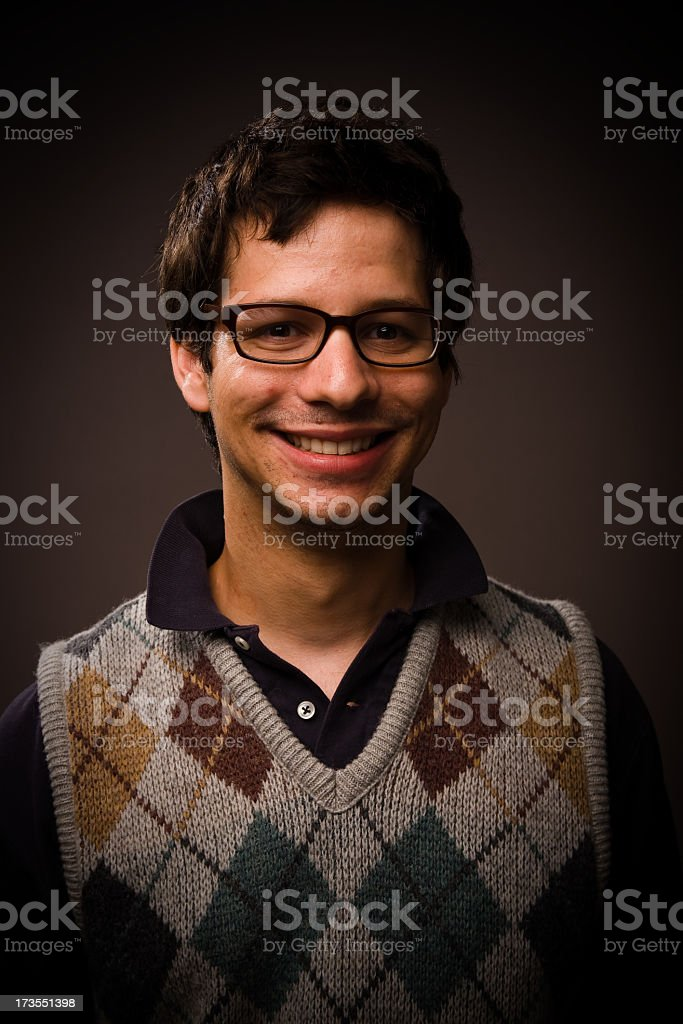 Young man with argyle sweater royalty-free stock photo