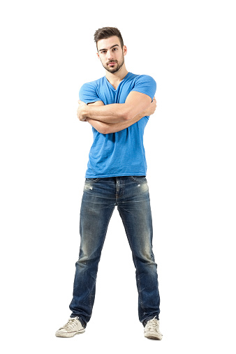 931173966 istock photo Young man with arms wrapped around himself looking at camera 526373259