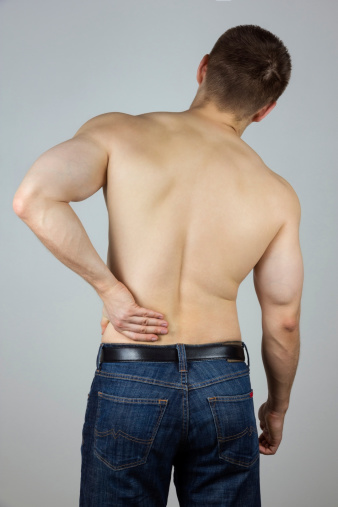 537234318 istock photo Young man with back pain 456106701