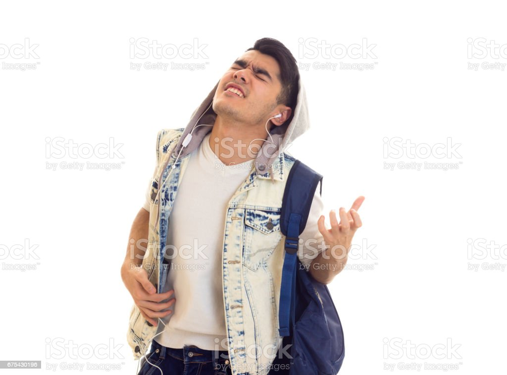 Young man with backpack and headphones royalty-free stock photo