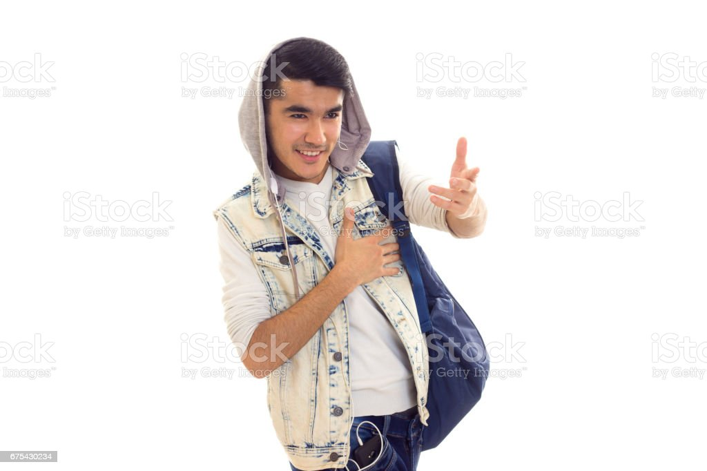 Young man with backpack and headphones photo libre de droits