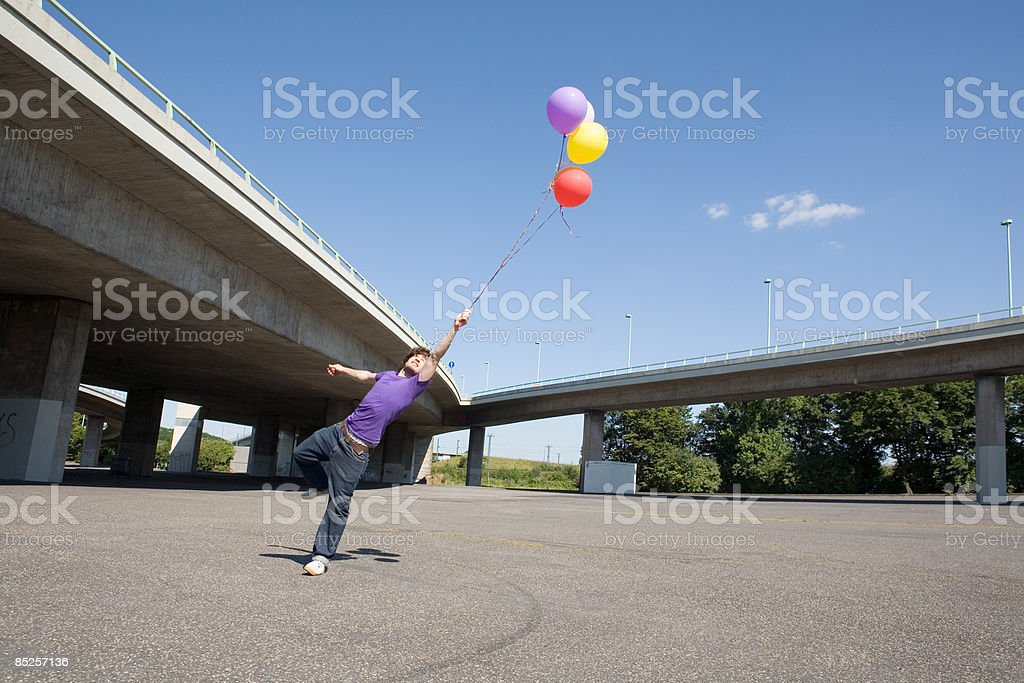 Young man with balloons royalty-free stock photo