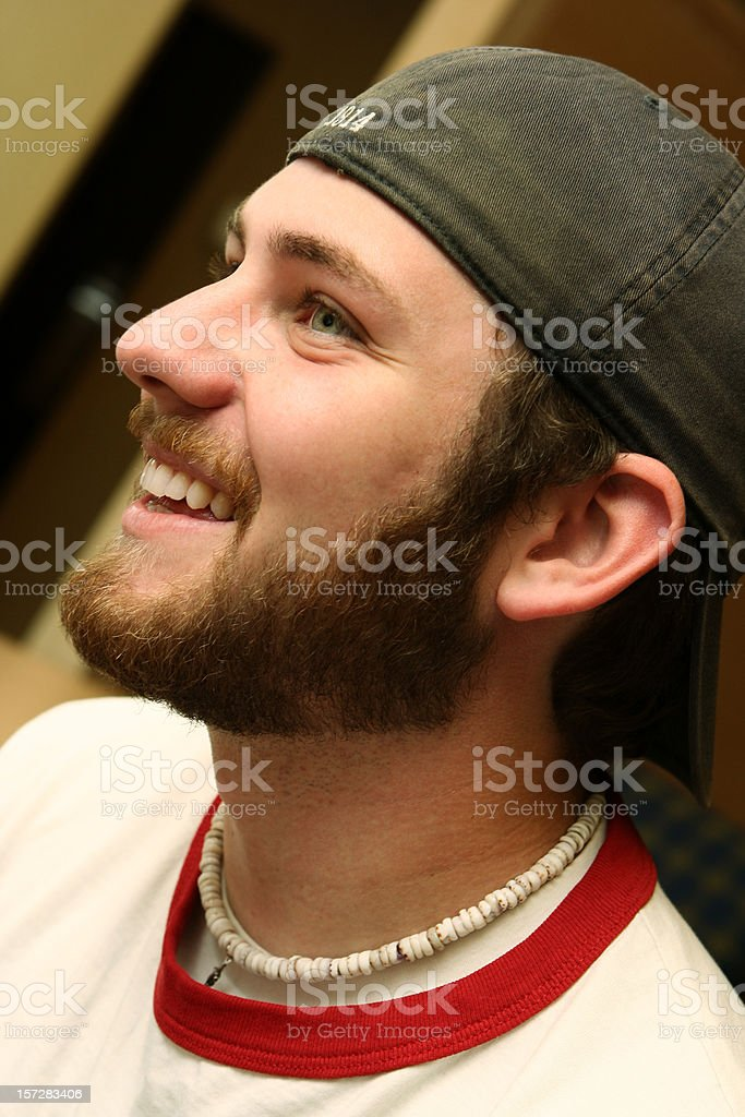 Young Man with Beard and Hat Smiling royalty-free stock photo