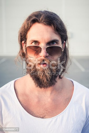 Young man with beard and sunglasses portrait