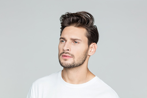 Young Man With Beard Looking Away At Copy Space Stock Photo - Download Image Now