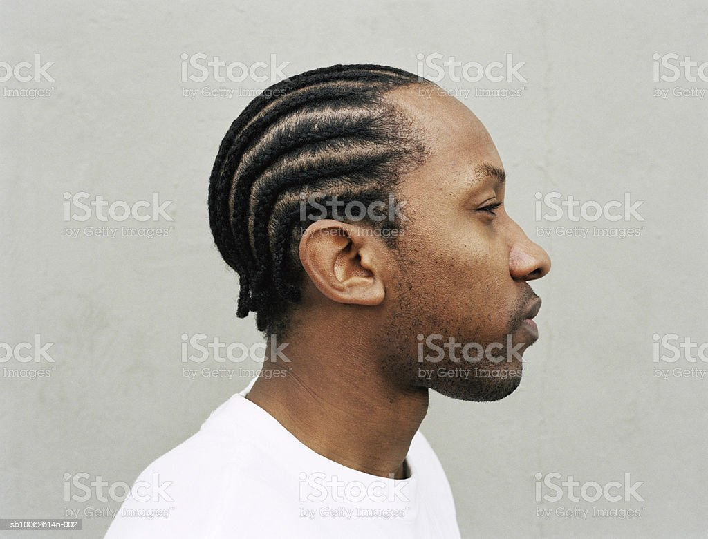 Young man with beard, side view, close-up royalty free stockfoto