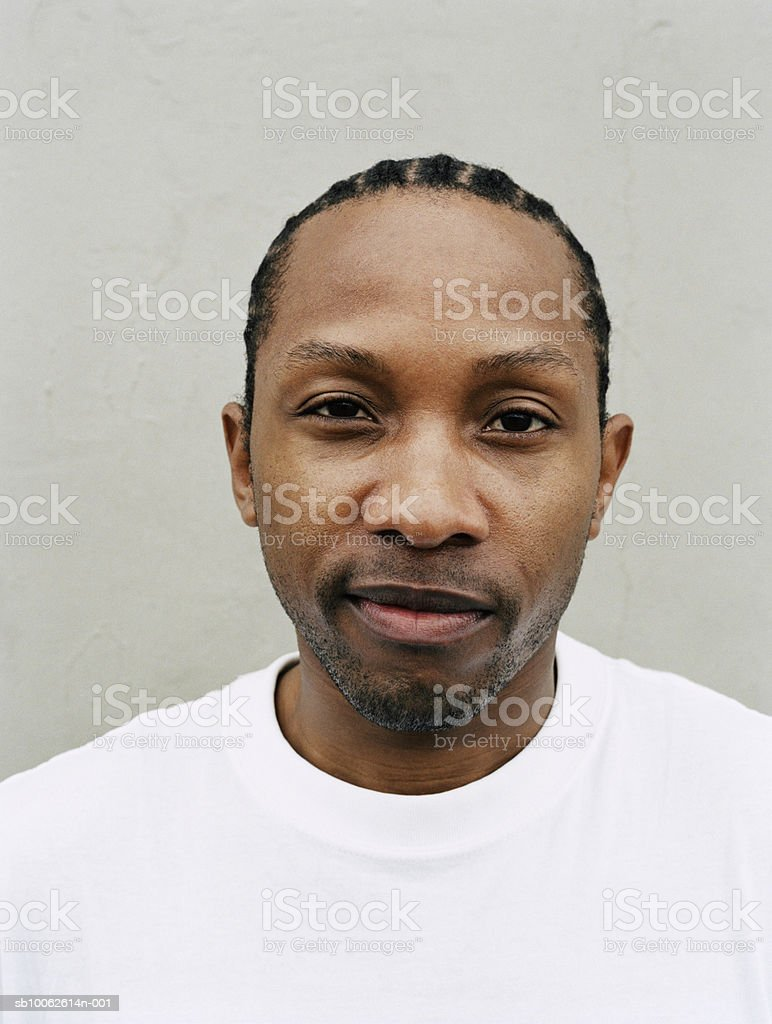 Young man with beard smiling, portrait, close-up royalty free stockfoto