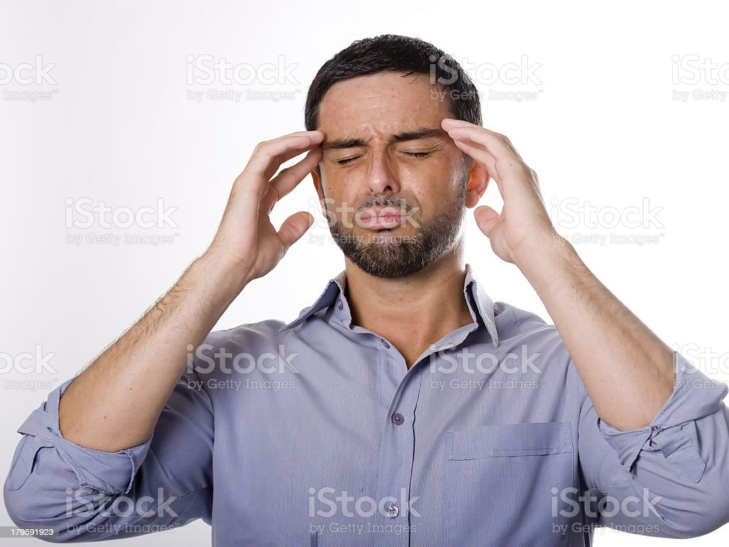 Young Man with Beard suffering Headache royalty-free stock photo