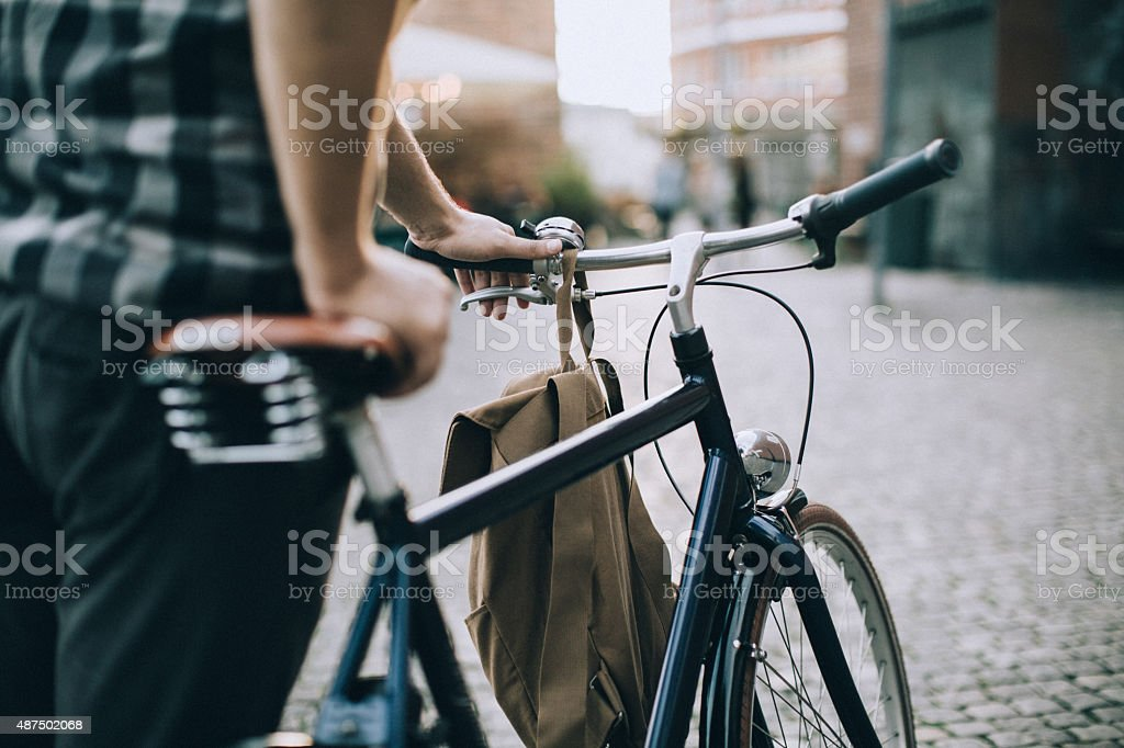 Young man with bicycle stock photo