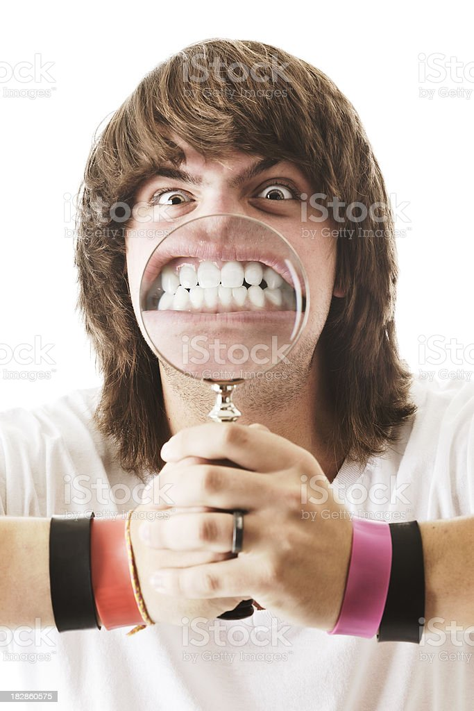 Young Man With Big Teeth in Magnifying Glass stock photo