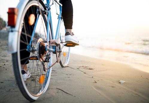 Youn man with classic bike at beach