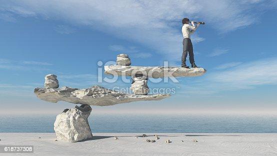istock Young man with binoculars 618737308