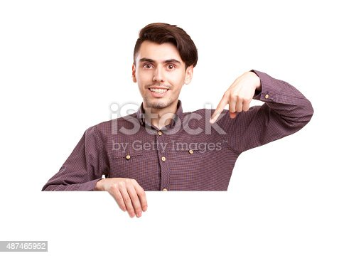 istock Young man with blank sign 487465952