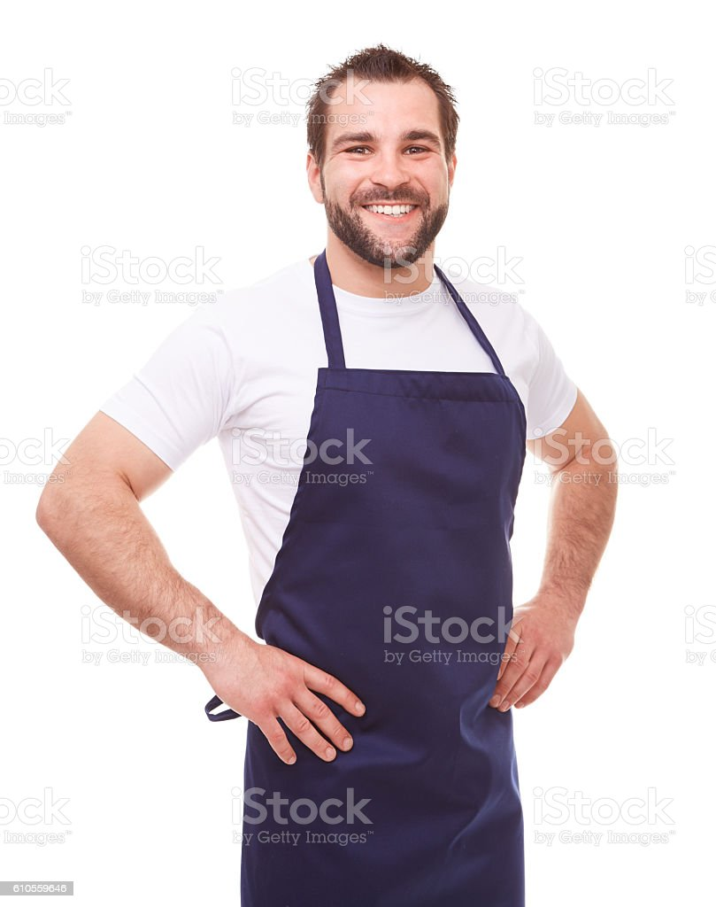 Young man with blue apron stock photo