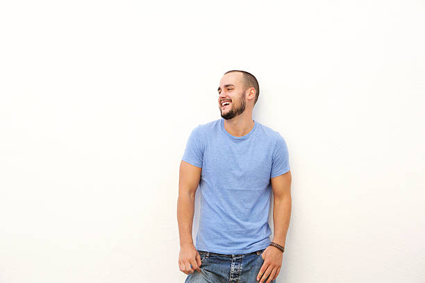 Young man with blue shirt laughing stock photo
