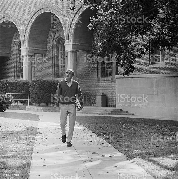Young man with books walking on campus picture id120427750?b=1&k=6&m=120427750&s=612x612&h=o3o9kjssl0bbccr7le3lq2zguxflnxmbeyfzerpxrtm=
