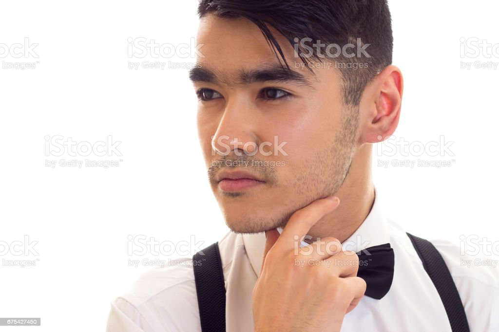 Young man with bow-tie and suspenders royalty-free stock photo
