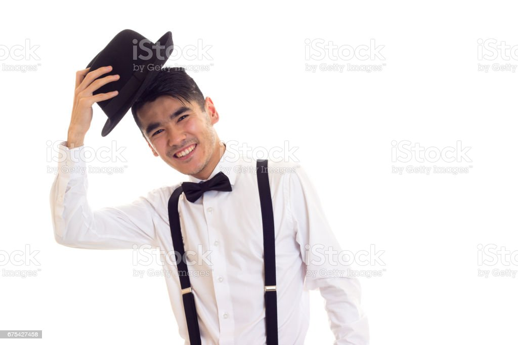 Young man with bow-tie, suspenders and hat photo libre de droits