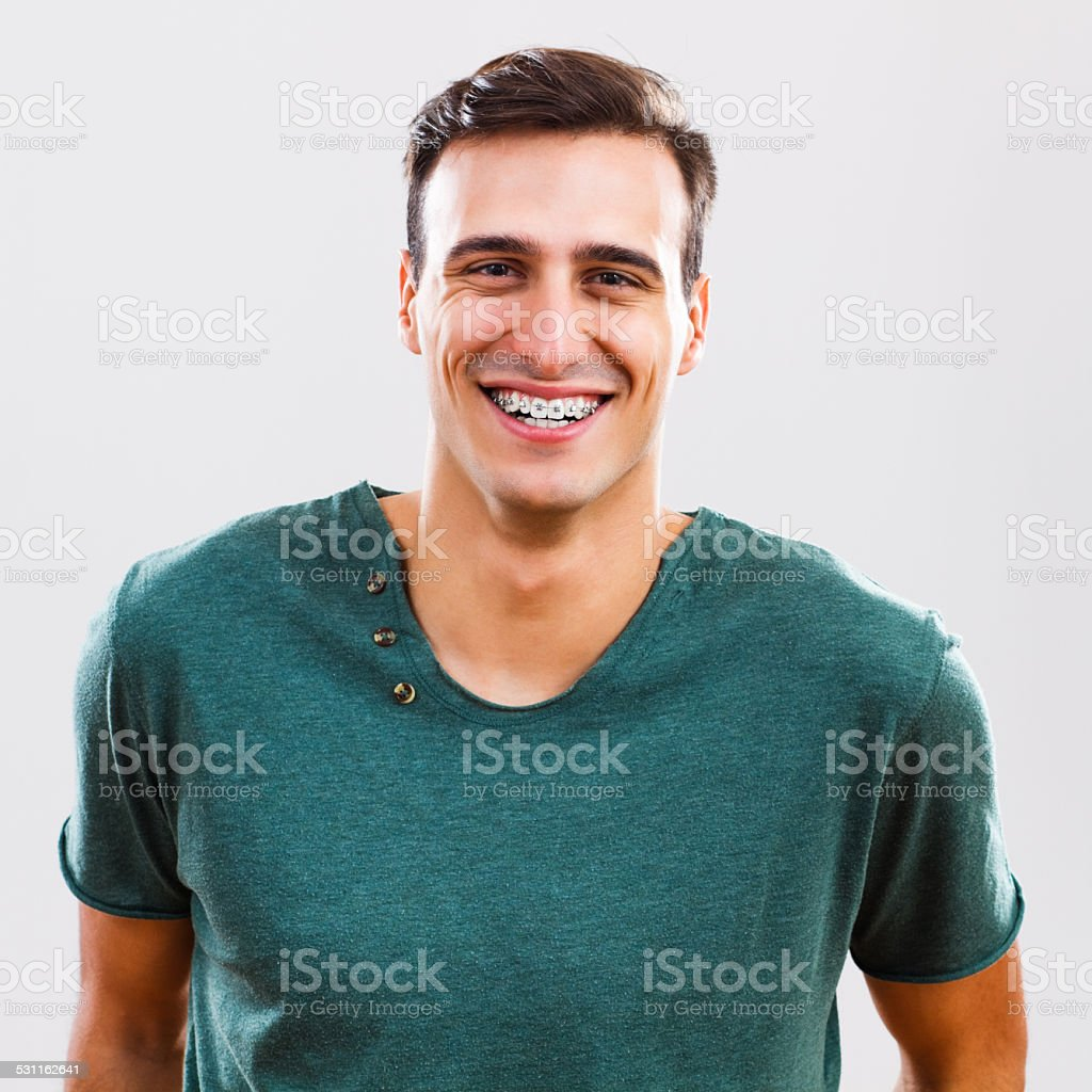 Young man with braces stock photo