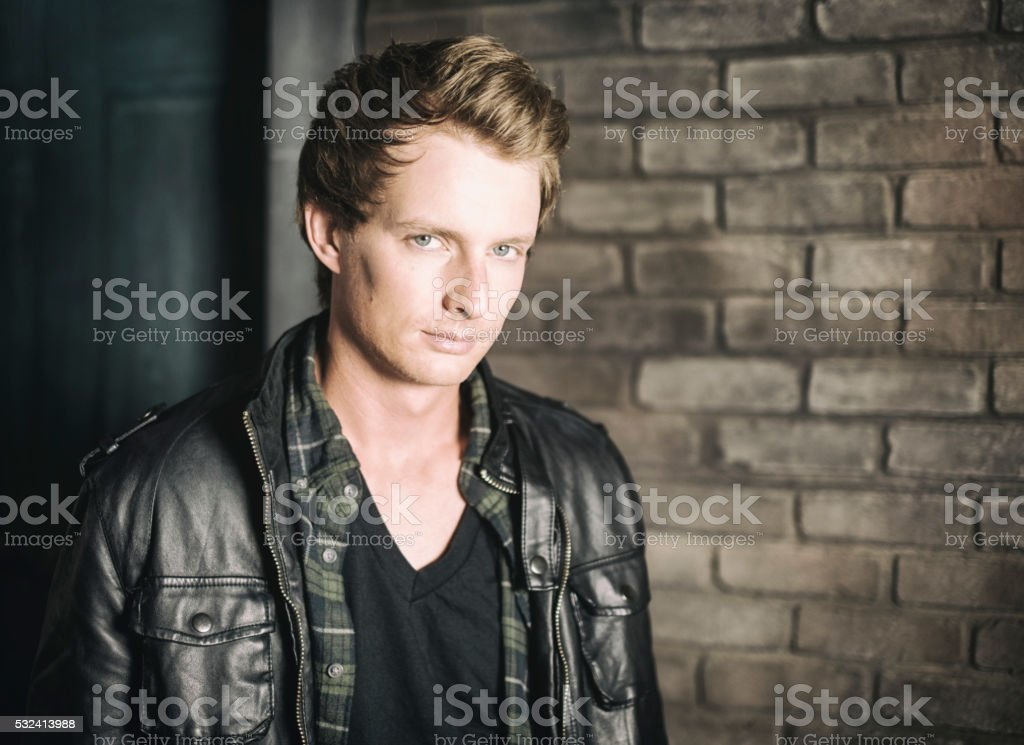 Young Man with Brick Wall royalty-free stock photo
