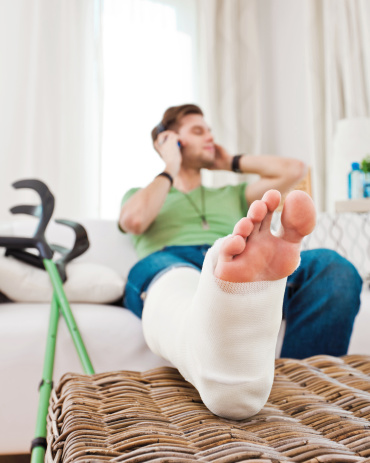 Young Man With Broken Leg At Home Stock Photo - Download ...
