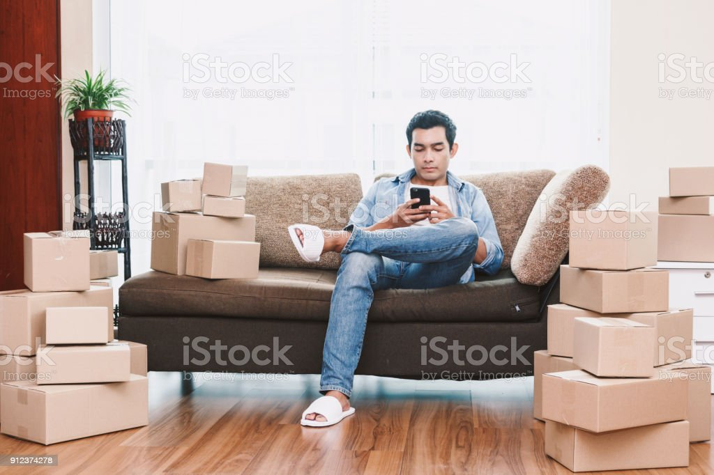 Young Man With Cardboard Box At Home Business Online And Delivery ...