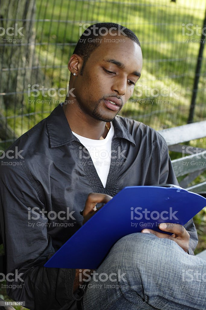 Young Man with Clipboard royalty-free stock photo