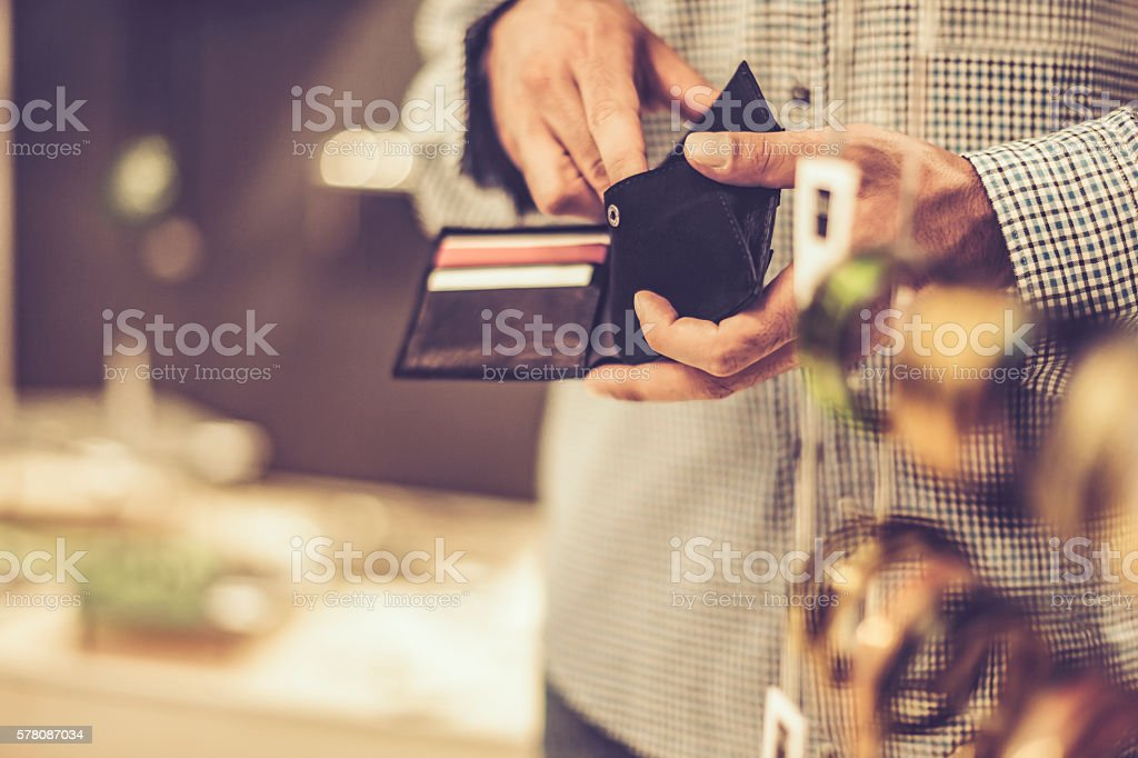 Young man with credit cards stock photo