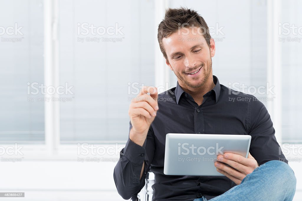 Young man with digital tablet stock photo