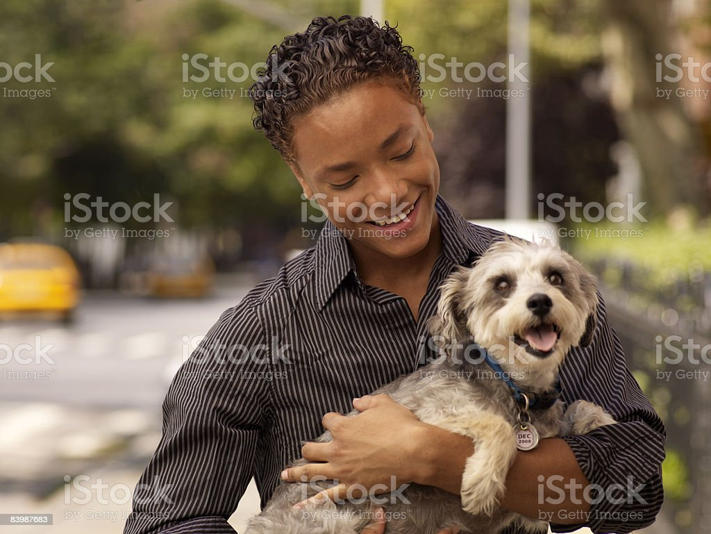 Young Man with Dog foto stock royalty-free