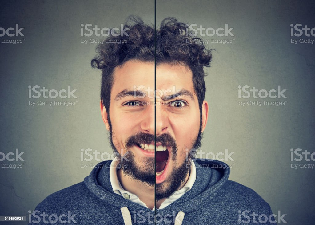 Young man with double face expression stock photo