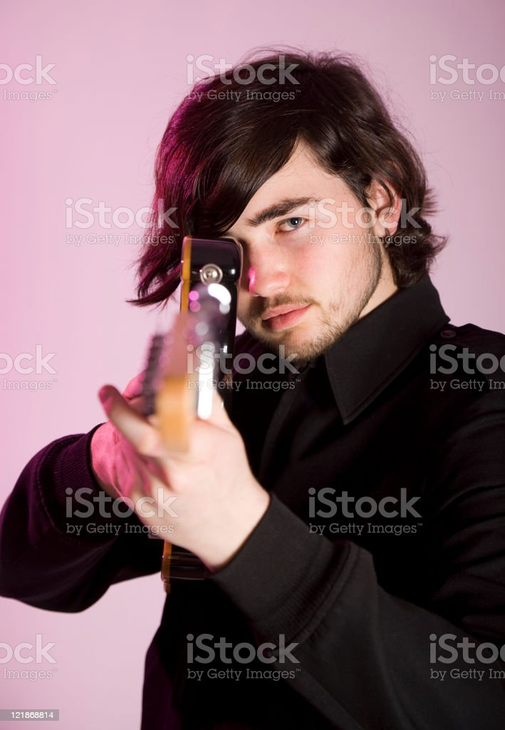Young Man with Electric Guitar stock photo