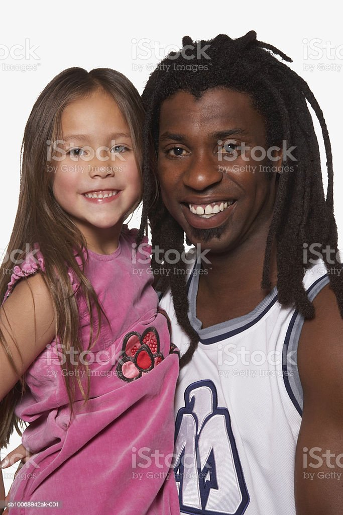 Young man with girl (4-5), smiling, portrait foto de stock libre de derechos