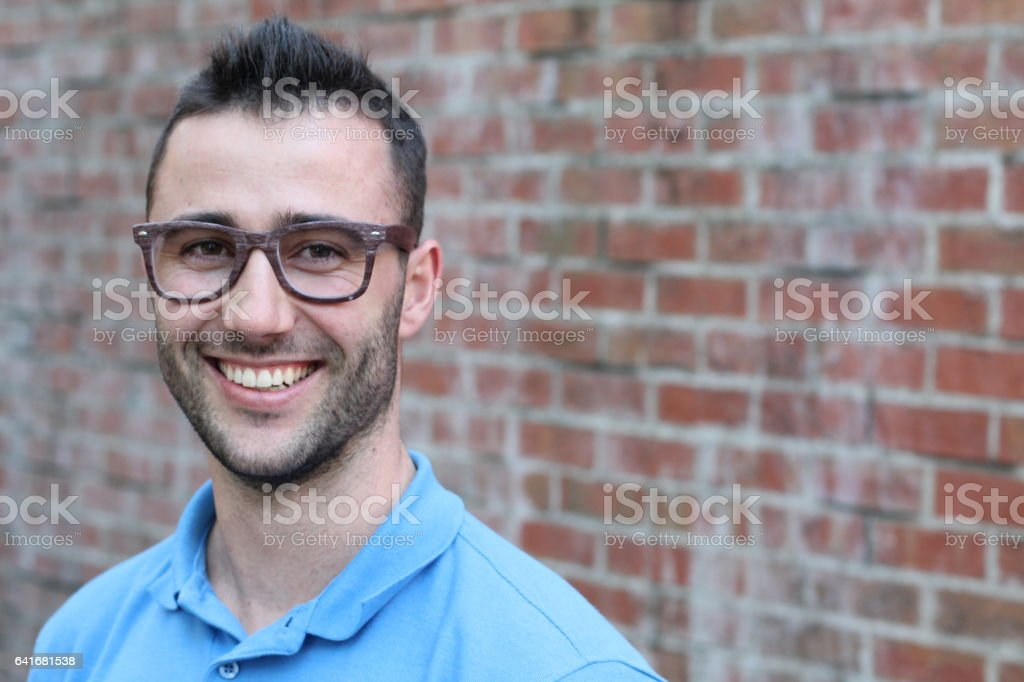 Young man with glasses smiling isolated stock photo