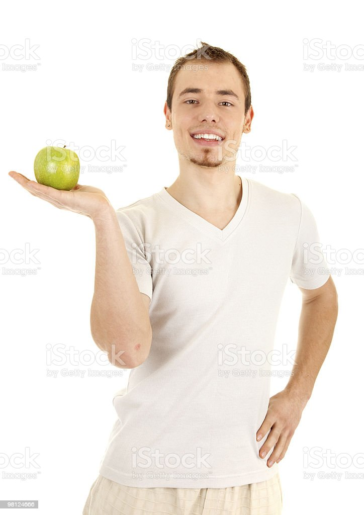 Young man with green fresh apple royalty-free stock photo
