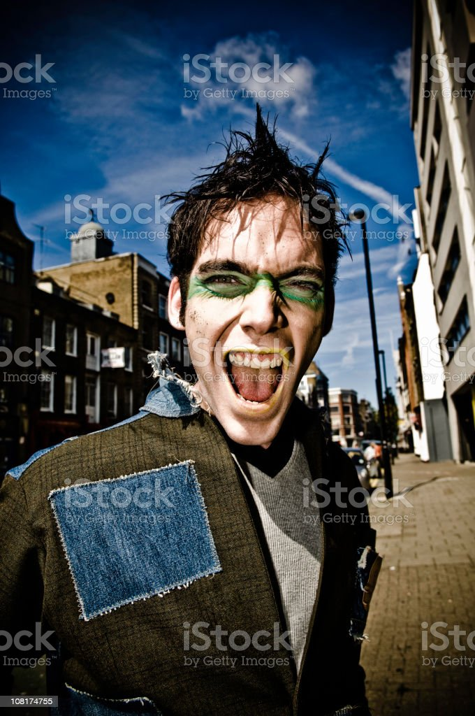 Young Man With Green Stripe Across Eyes royalty-free stock photo