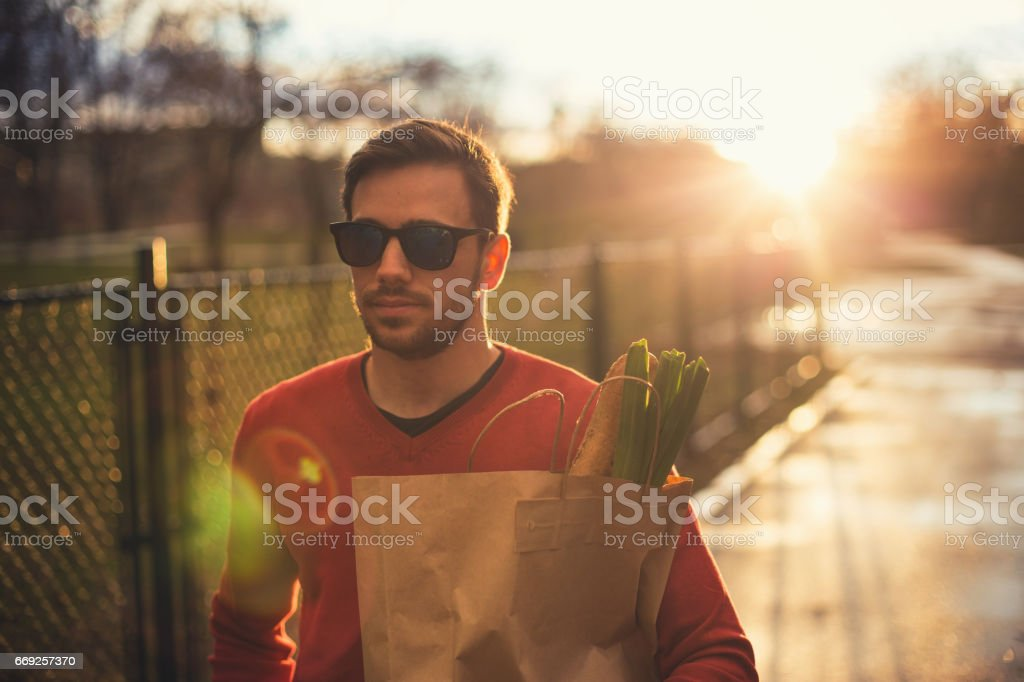Young Man with groceries stock photo