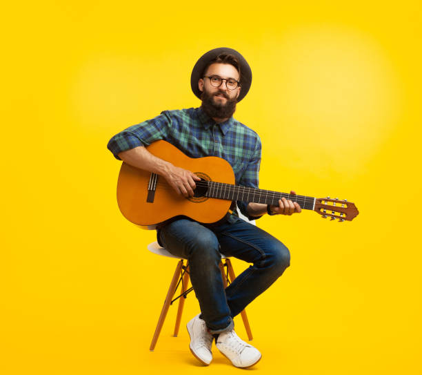 young man with guitar in studio - musician stock photos and pictures