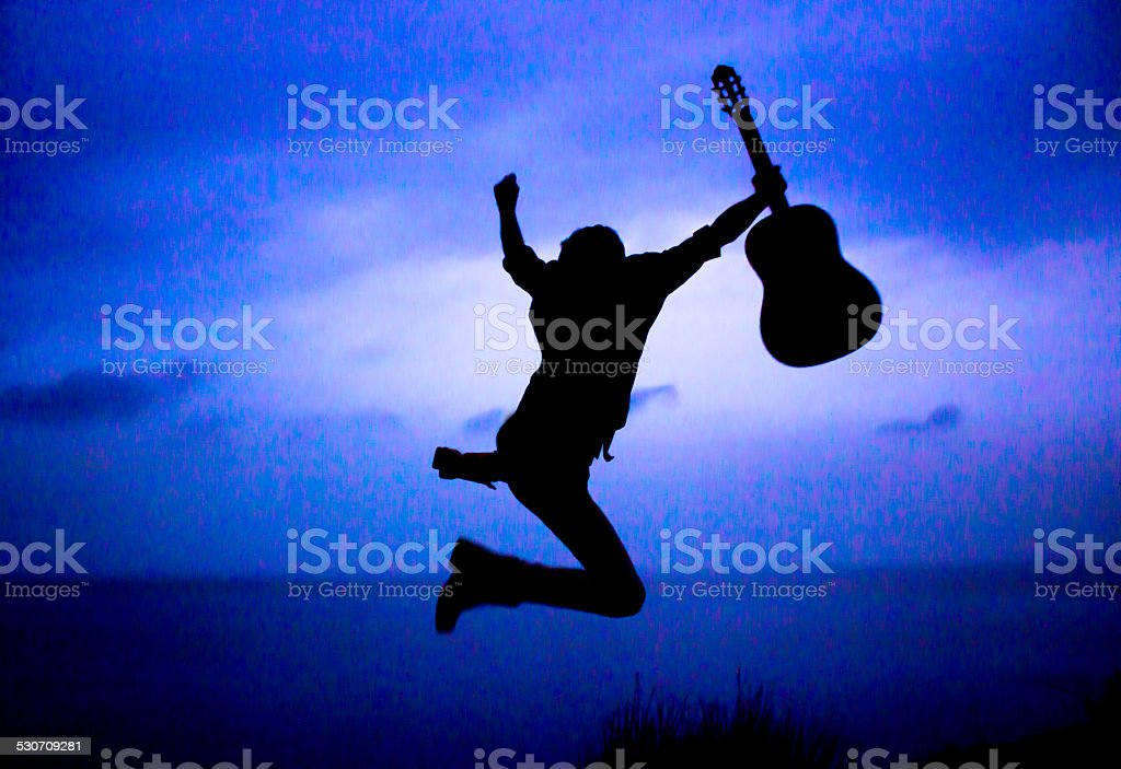 Young man with guitar stock photo
