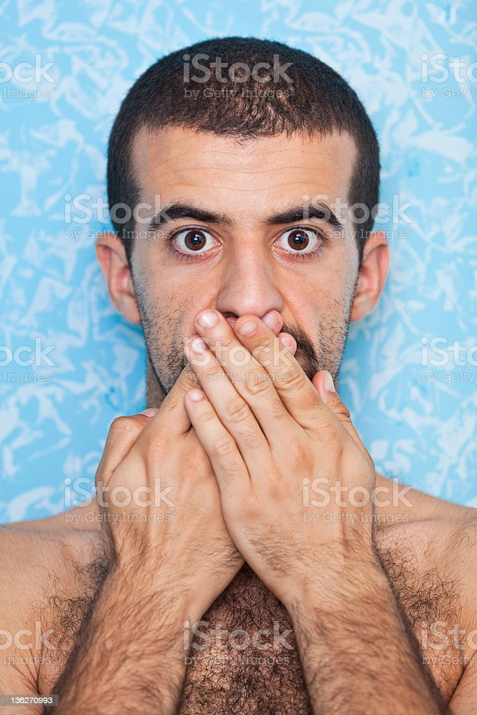 Young Man with Hands on Mouth royalty-free stock photo