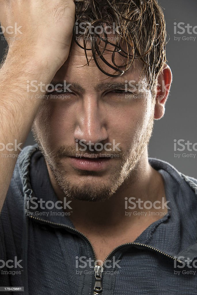 Young man with headache (real people) royalty-free stock photo