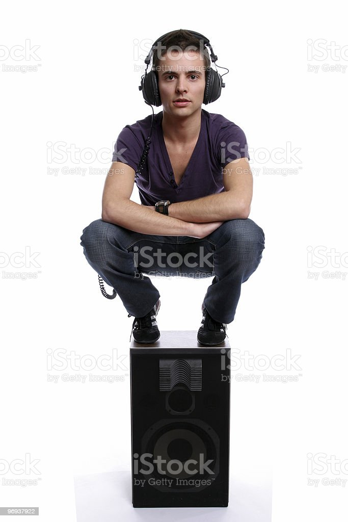 Young man with headphones, stading in a speaker royalty-free stock photo