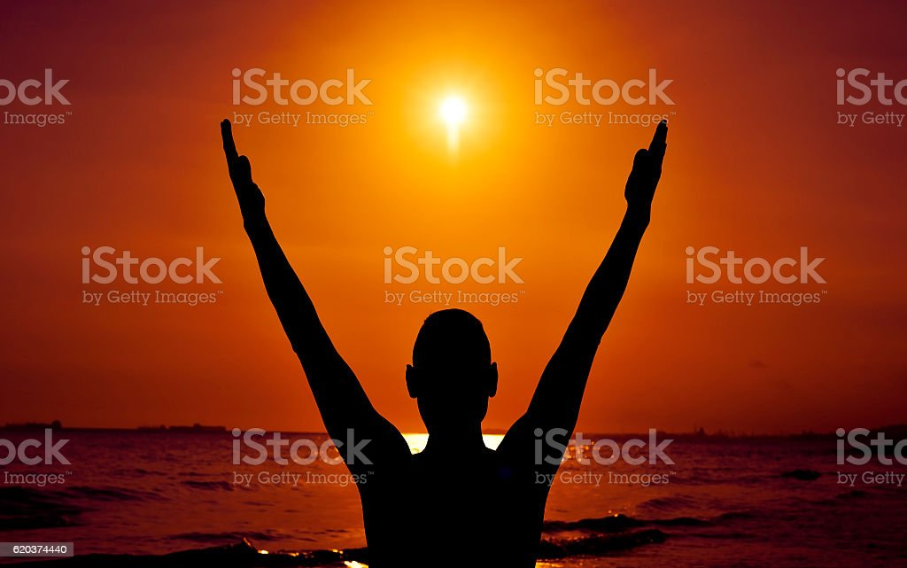 young man with his arms in the air foto de stock royalty-free