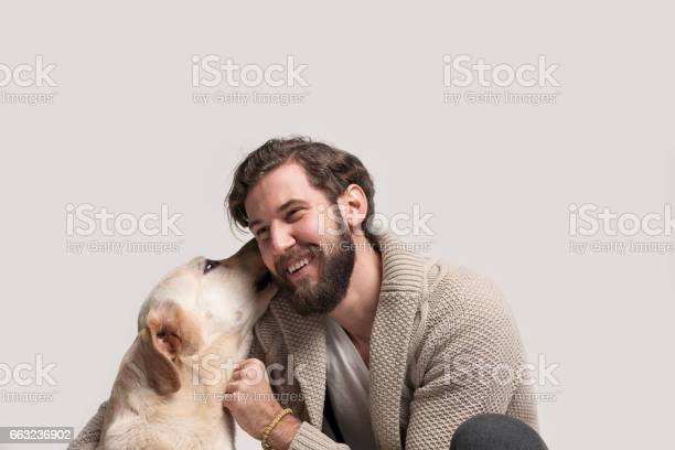 Young man with his dog labrador picture id663236902?b=1&k=6&m=663236902&s=612x612&h=sjc2zqtdqmvym1w8rh9youddvfy6s8es2iucekljofm=