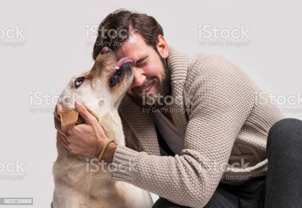Young man with his dog labrador picture id663239666?b=1&k=6&m=663239666&s=612x612&h=yzgnhalpqx8idaftlcesbaisax1xss3t4nn18gejqxu=